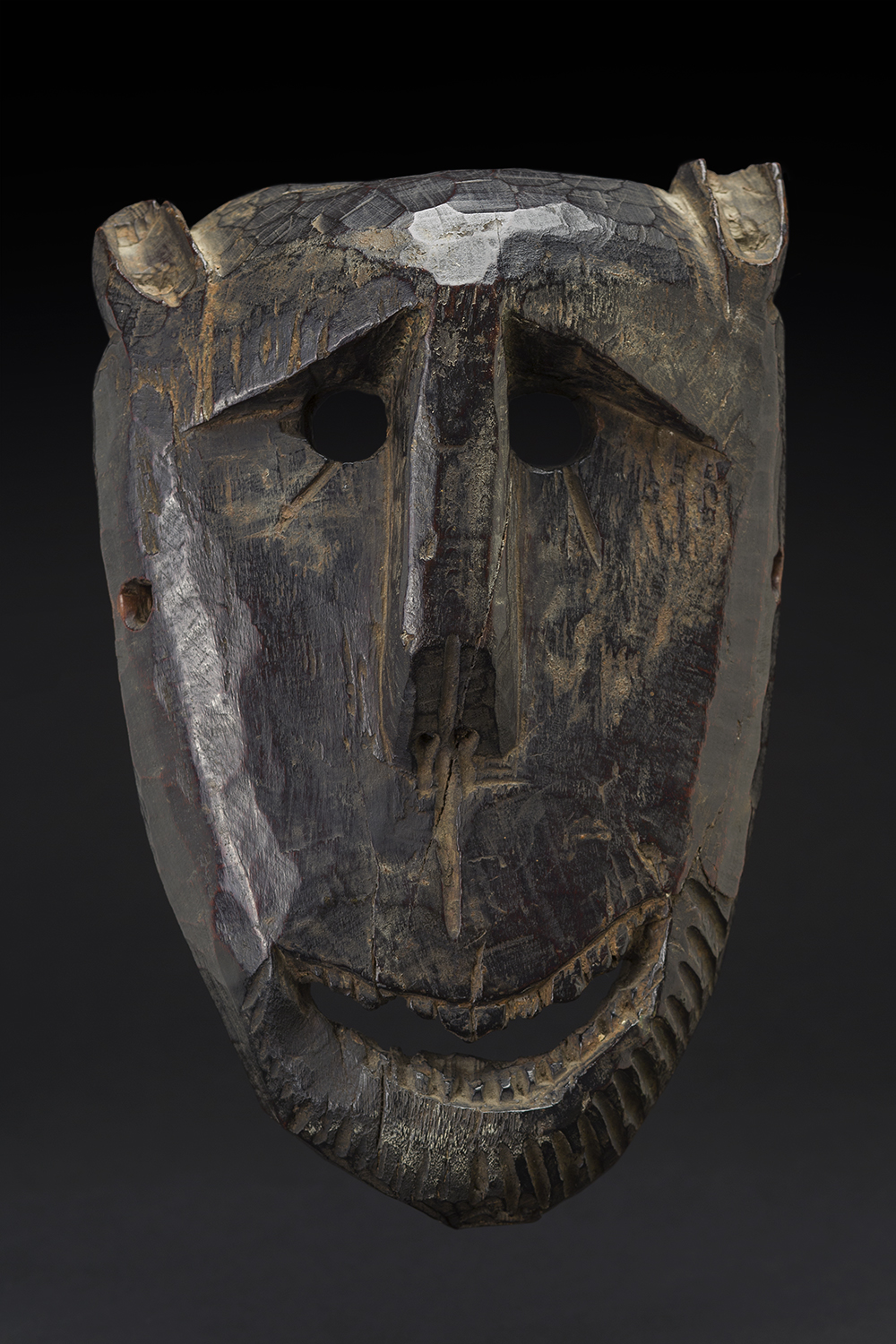 Masks    Nepal  , circa 19th C. Wood 12 x 7.5 x 3 inches 30.5 x 19.1 x 7.6 cm M 195s
