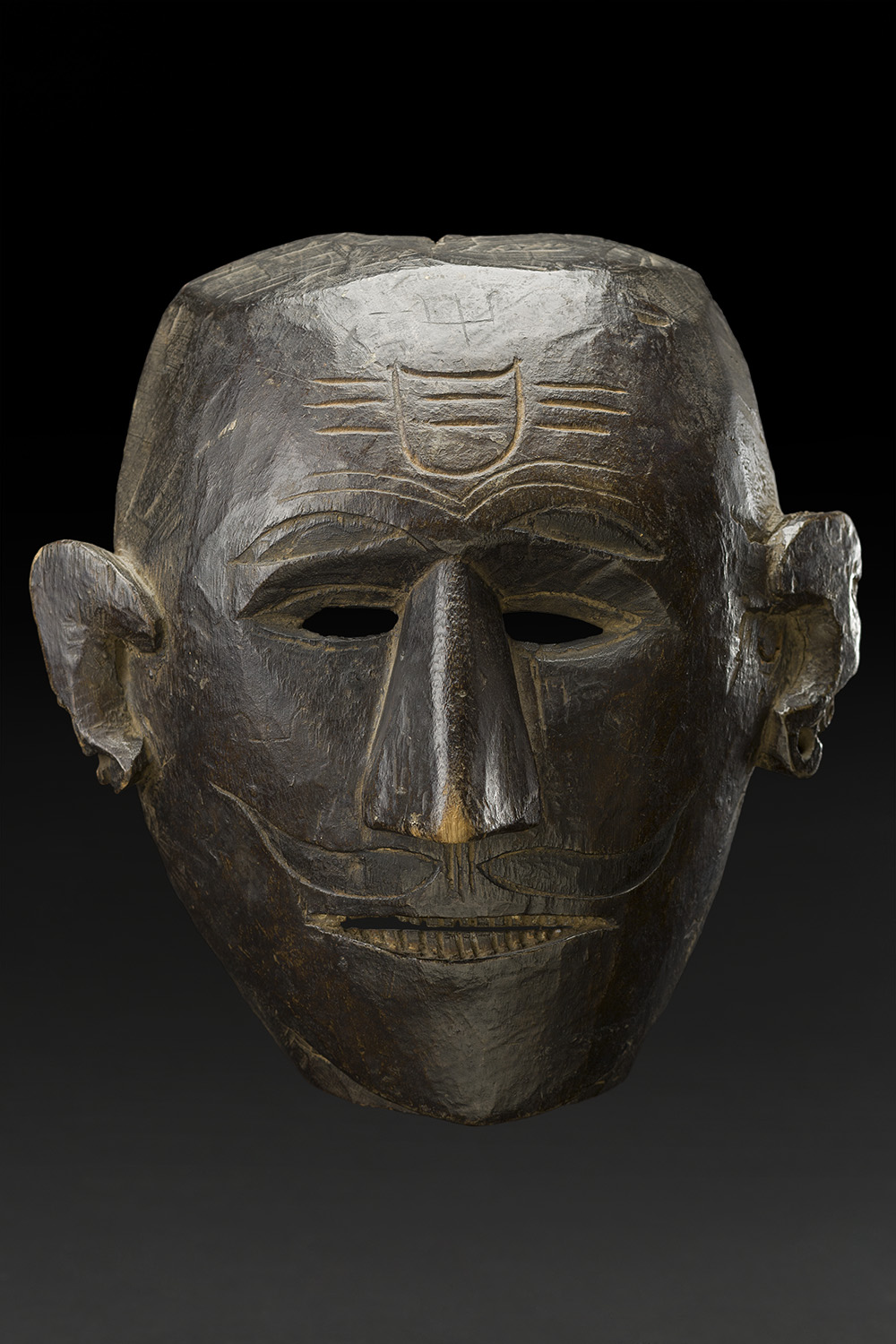 Masks    Nepal  , Early 20th C. Wood 11.5 x 10.4 x 5.5 inches 29.2 x 26.4 x 14 cm M 220s