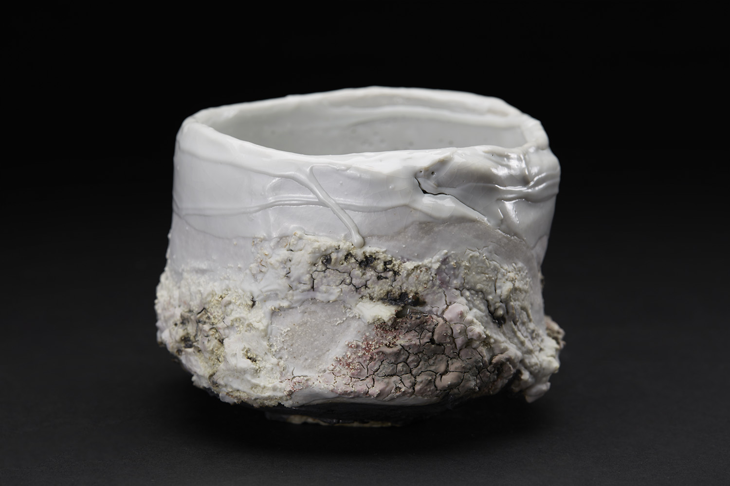 Eddie Curtis Chawan, 2016 Stoneware, reduction fired in brick built oil kiln at 1300 Celsius. Kurinuki technique, applied texture and oxides to outer surface, snow white shino to rim and inner surface 3.15 x 4.72 x 4.72 inches 8 x 12 x 12 cm ECu 10