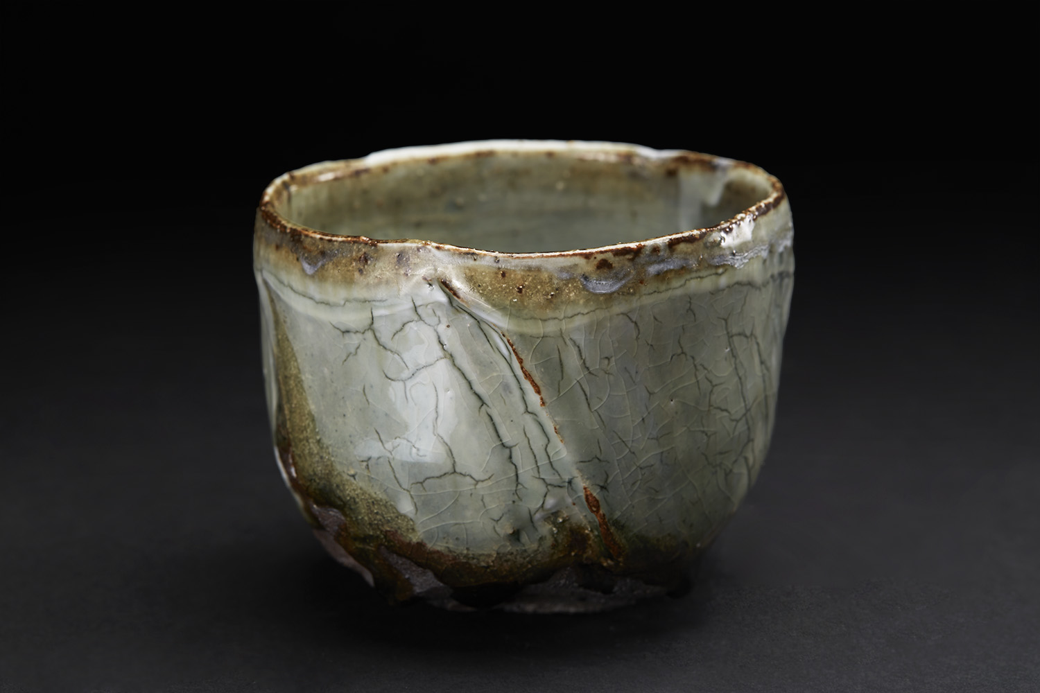 Margaret Curtis Chawan, 2016 Stoneware, reduction fired in brick built oil kiln at 1300 Celsius. Thrown and altered, black body with porcelain slip and celadon glaze. 3.5 x 4.5 x 4.5 inches 8.9 x 11.4 x 11.4 cm MCu 2