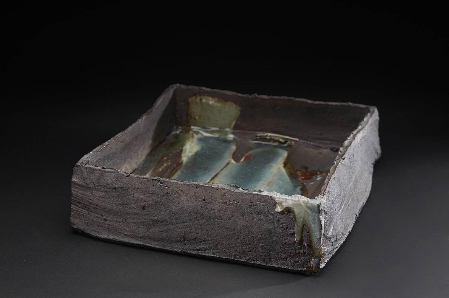 Margaret Curtis Square Slabbed Dish, 2016 Stoneware, reduction fired in brick built oil kiln at 1300 Celsius. Thrown and altered, black body with over-pourings of porcelain slip and celadon glaze. 3.5 x 13 x 13 inches 8.9 x 33 x 33 cm MCu 6