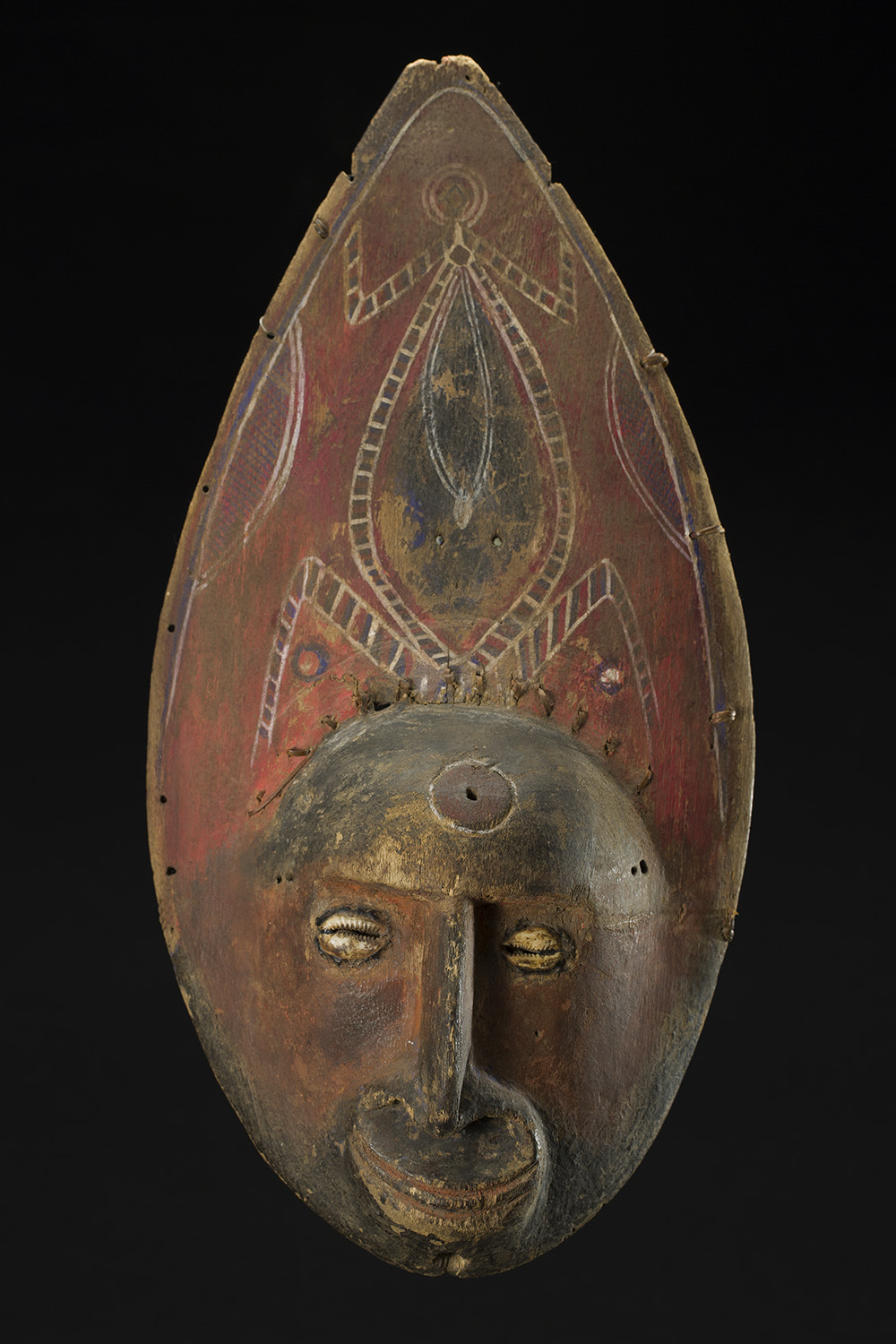Yam Mask, Abelam People, Wosera Subgroup, East Sepik Province, PNG, Ex: Michael Hamson, Jolika Collection, John and Marcia Friede  , Early 20th C. Wood, shells, and pigment 16 x 8 x 3 inches 40.6 x 20.3 x 7.6 cm w/ stand: 19.5 x 8 x 4.5 inches M 265s