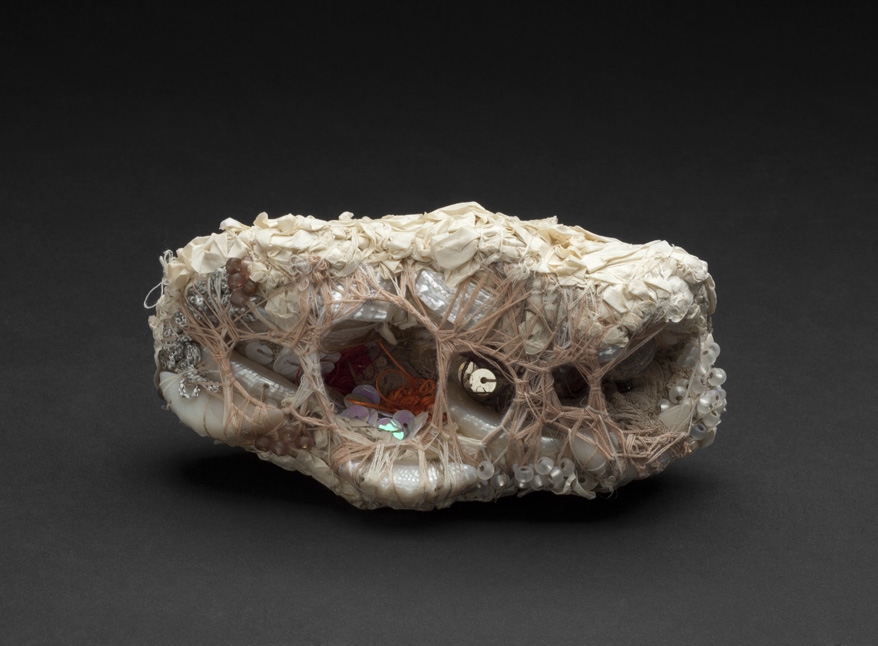 Sandra Sheehy Untitled, 2012 Fabric, paper, thread, beads, sequins, seashells  5.5 x 3 x 2.5 inches 14 x 7.6 x 6.4 cm SSe 82