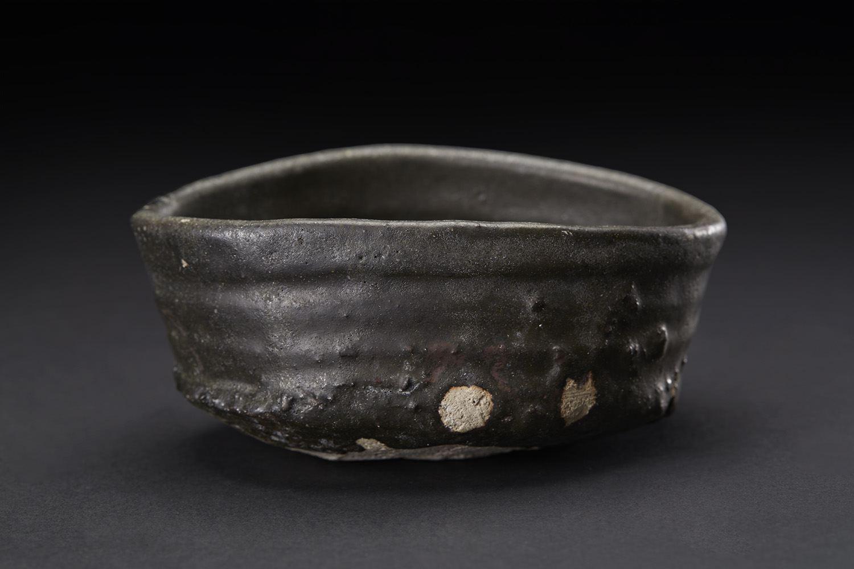 Shiro Tsujimura    Kuro-Oribe Chawan  , 2007 Mixed iron, charcoal (mokutan), Chooseki, etc, and firing with 1300C. And then proceed by rapid cooling, make it become black color 3 x 6.5 x 5 inches 7.6 x 16.5 x 12.7 cm STs 2