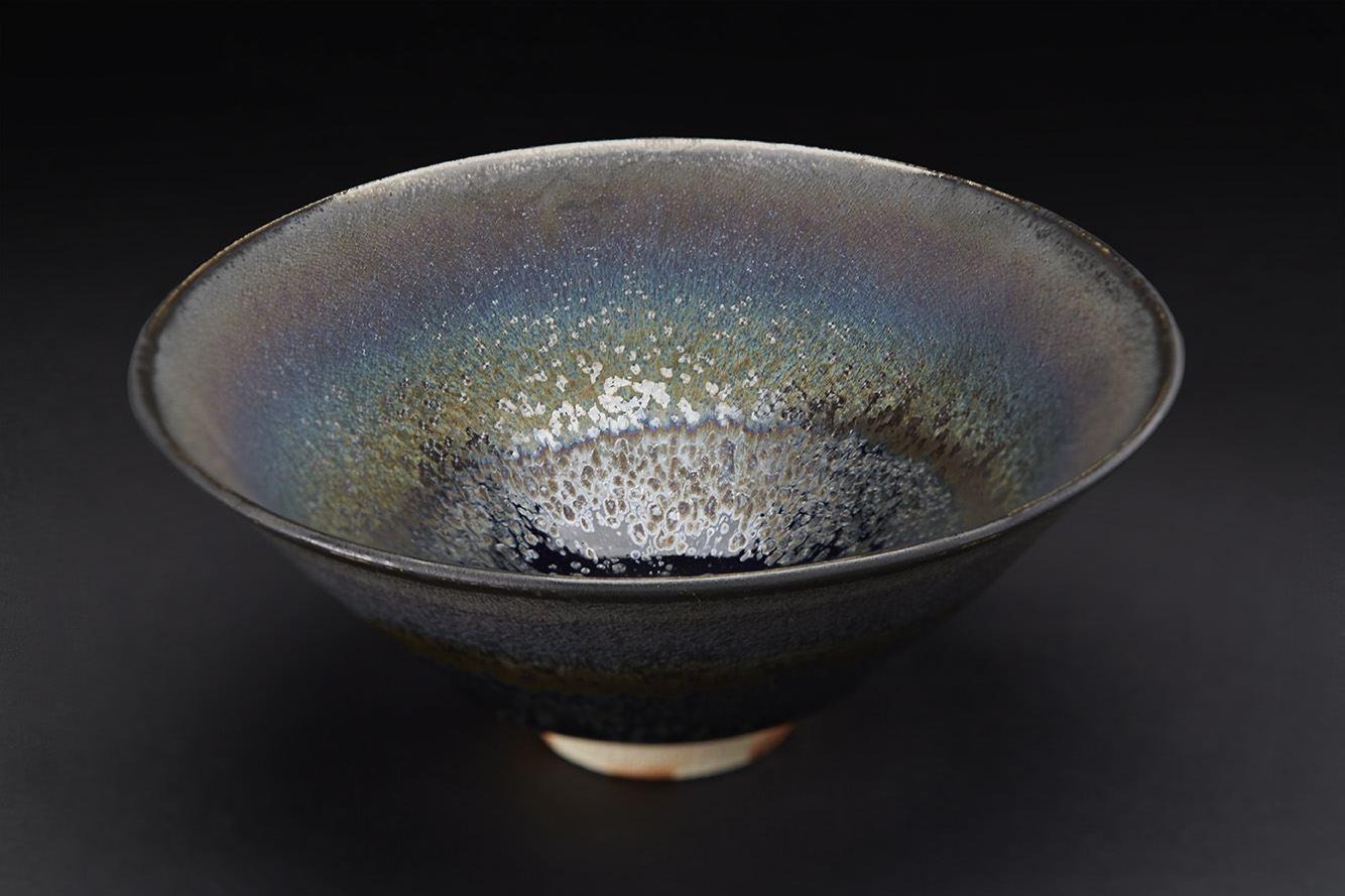Wasaburo Takahashi    Seiran Tenmoku-yu Chawan  , 2011 Finishing: double dipping with Tenmoku glaze (black colored glaze) and Seiran glaze (blue colored glaze); glaze: Tenmoku-glaze (iron glaze); firing: reduction firing in gas kiln at 1250 C, fired twice 2.5 x 6 x 6 inches 6.4 x 15.2 x 15.2 cm WTa 1