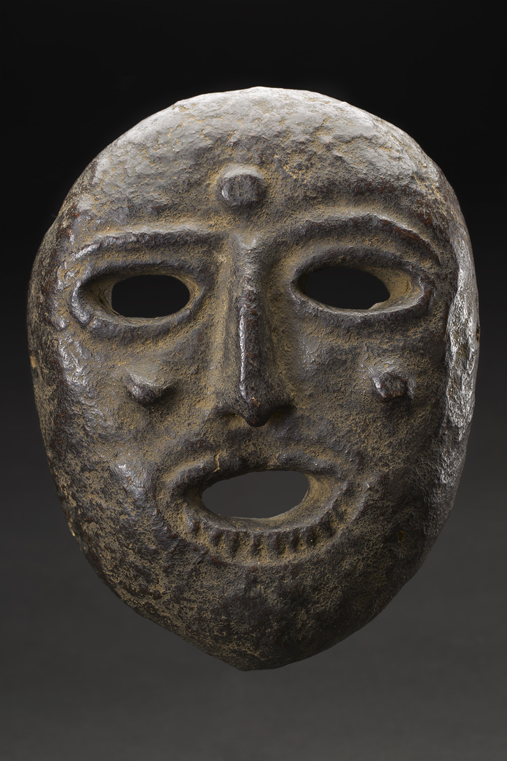 Masks    Nepal  , Early 20th C. Cow dung, clay, organic materials 11 x 8.5 x 3 inches 27.9 x 21.6 x 7.6 cm M 226