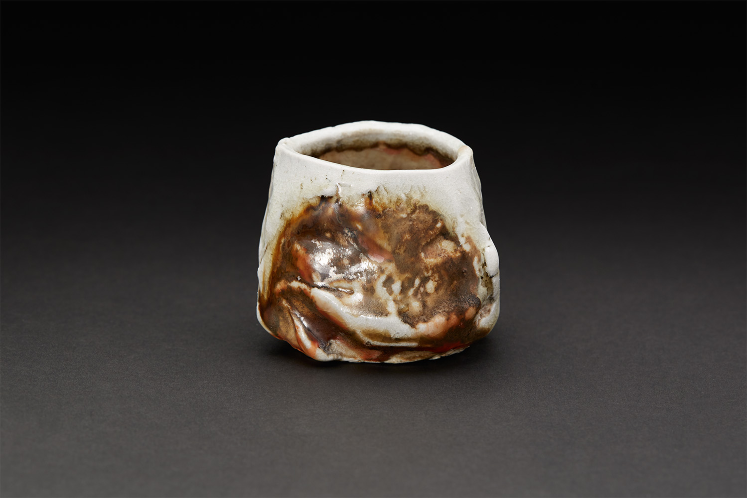 Lucien M. Koonce    Guinomi  , 2017 Hand carved and hollowed (kurinuki technique) stoneware clay and natural ash glaze; wood fired (anagama) for five days to c/12 2.5 x 2.5 x 2.5 inches 6.4 x 6.4 x 6.4 cm LKo 7