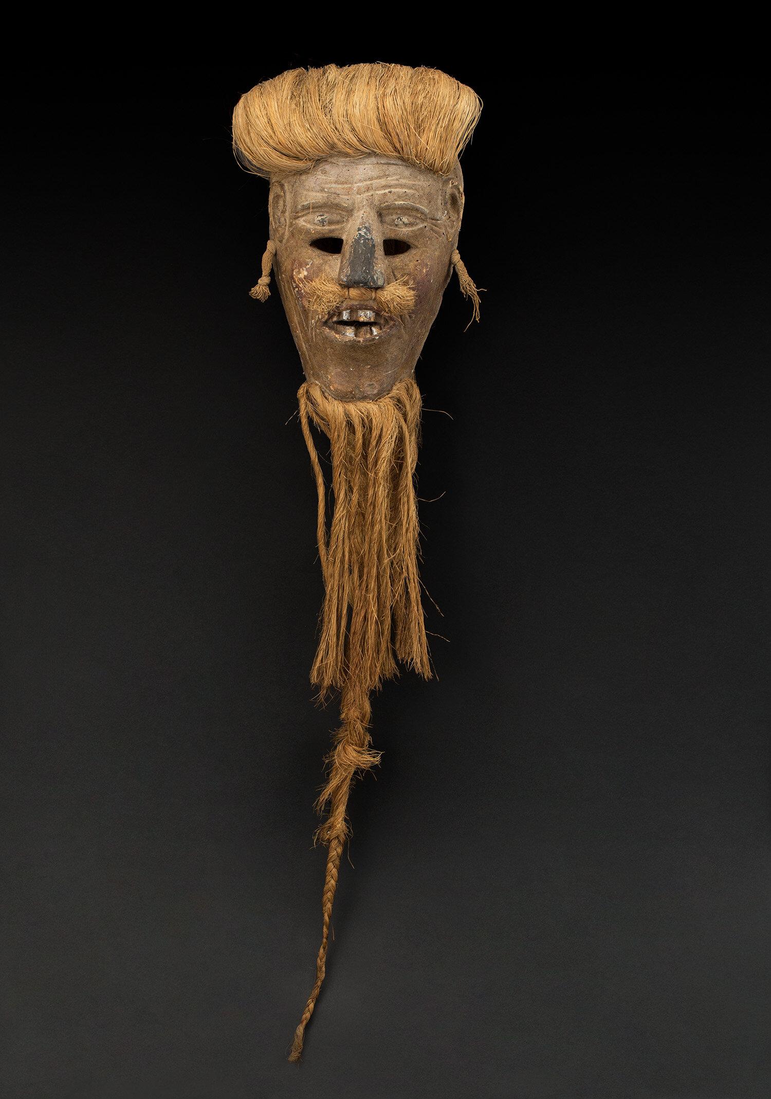 Masks  Tlaxcala Hermitano character, Pastorela dance  , mid 20th C. Polychrome wood, aluminum foil, sisal 36 x 9 x 5 inches 91.4 x 22.9 x 12.7 cm M 373