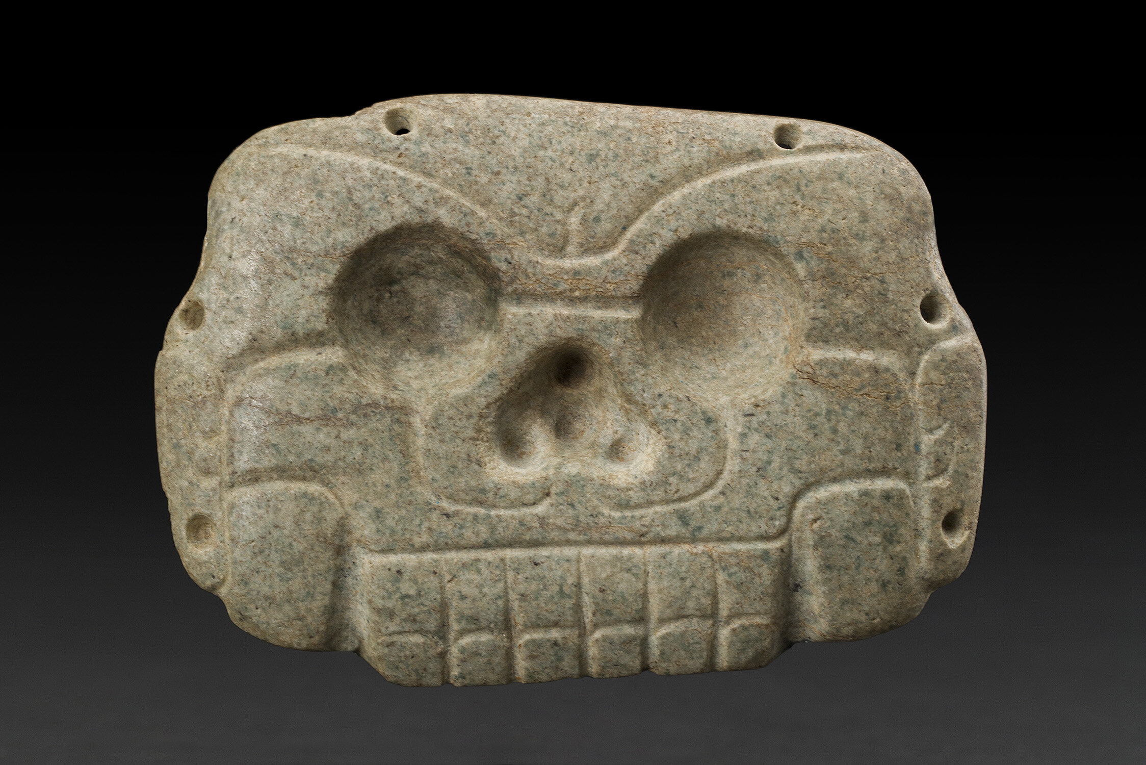 Masks  Mayan Skull Head Pendant  , 600-900 CE Green Stone 3 x 4.25 x .375 inches 7.6 x 10.8 x 1 cm M 411