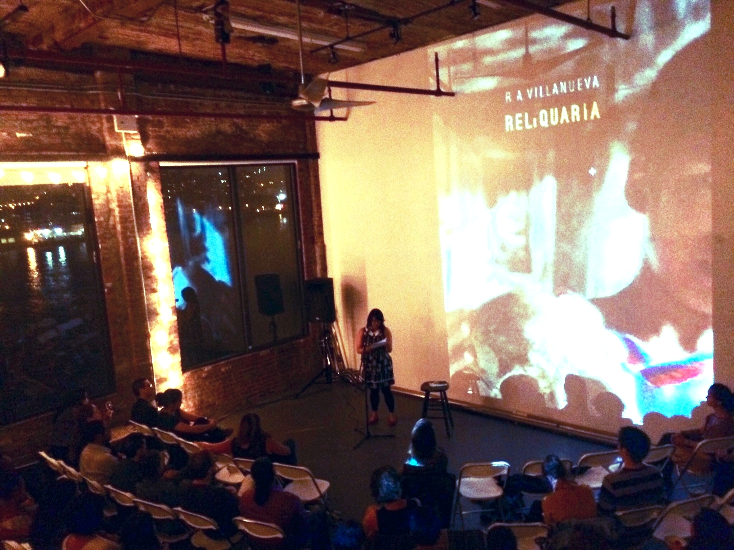 "Celebrating the launch of R. A. Villanueva's debut collection,  Reliquaria , by reading his poem, ""Swarm,"" and my poem, ""Swarm."" Photo courtesy of R. A. Villanueva."