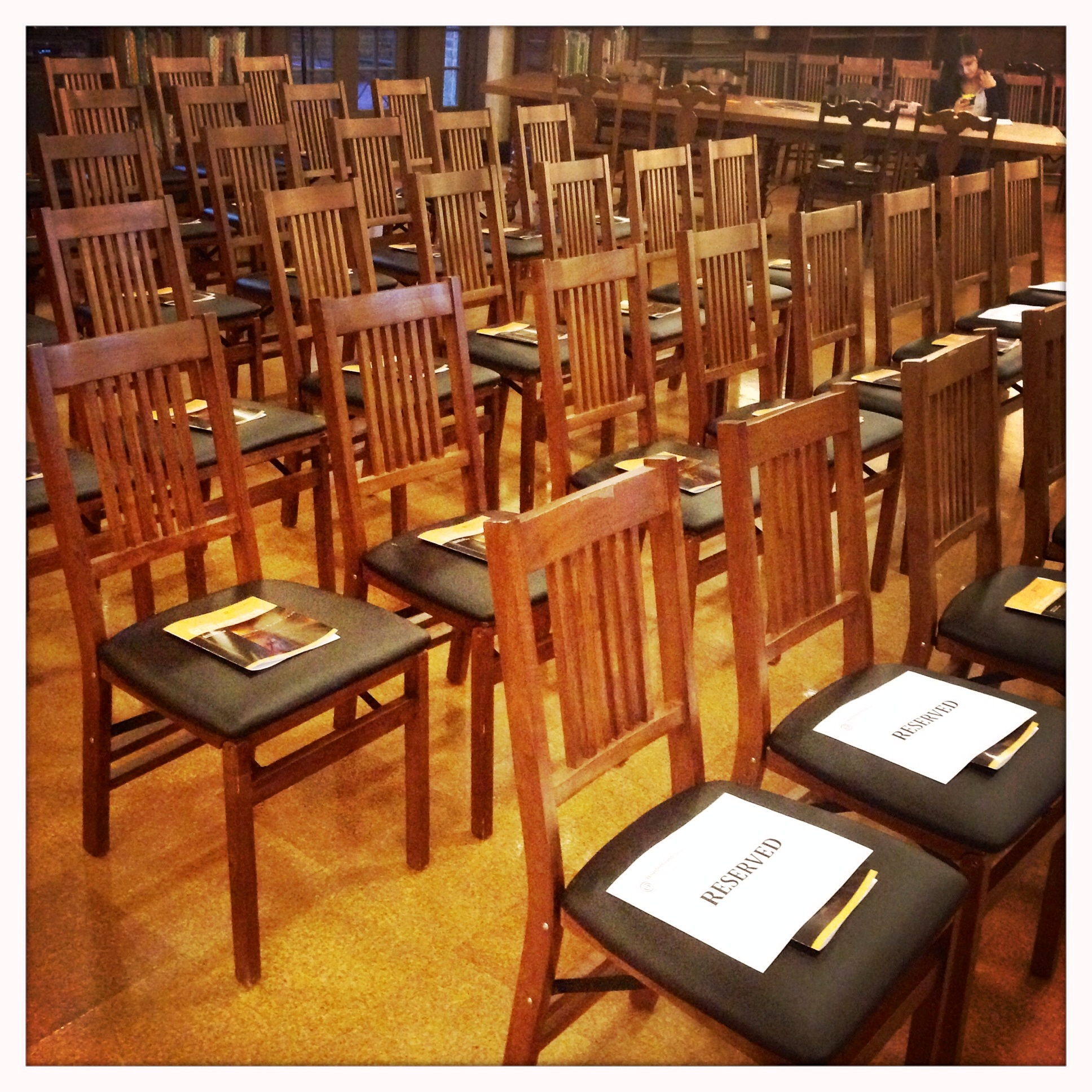 Programs (with lyrics insert) and chairs.