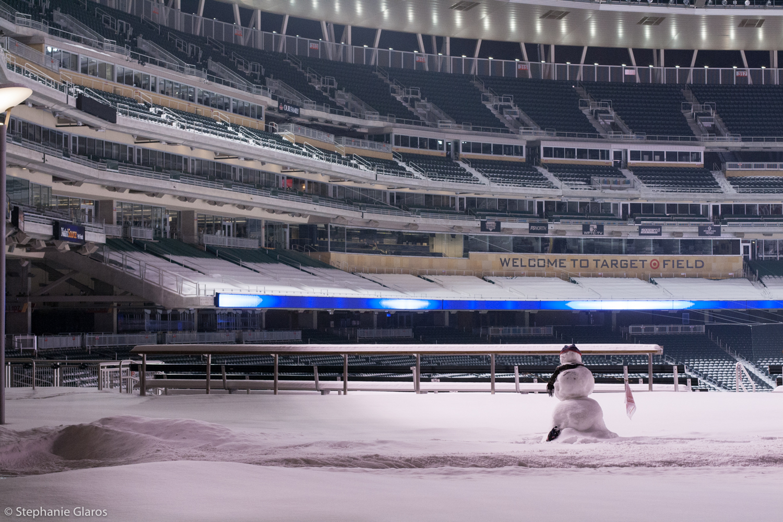 Snowman waving Homer Hanky after a snowstorm at Target Field, Minneapolis