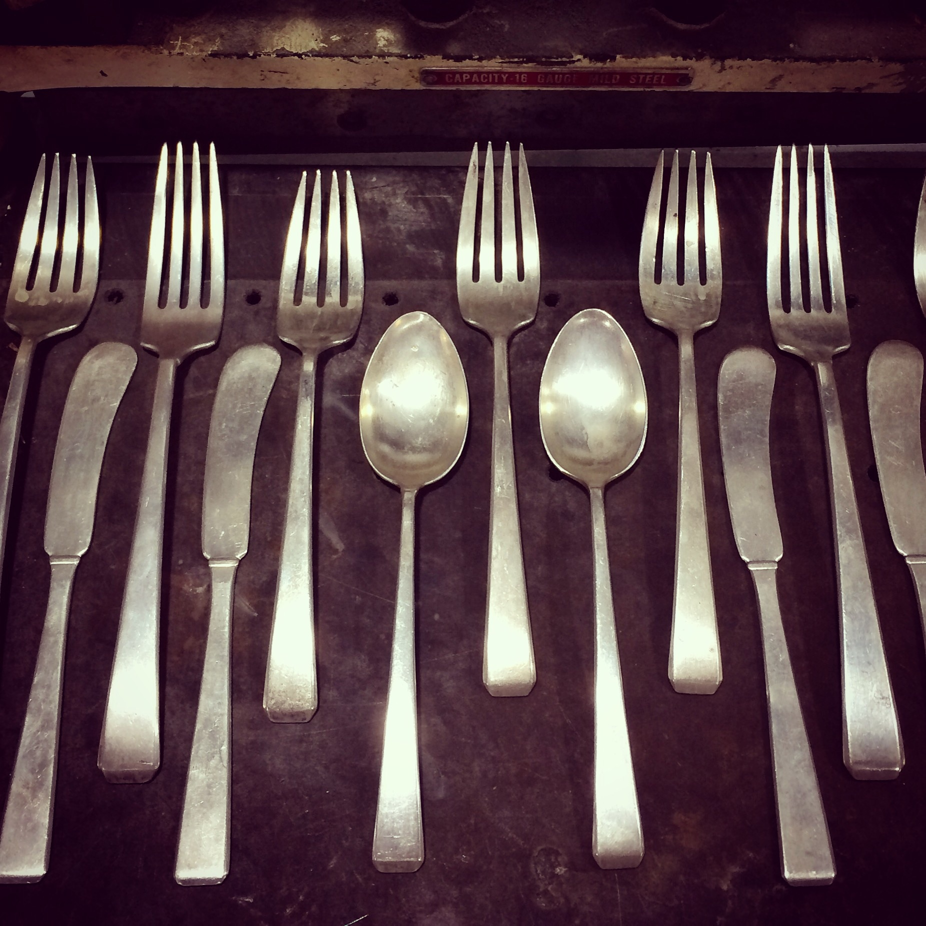 ...ready to cut and melt pieces of history (sterling silverware) for a new life as artisan jewelry.