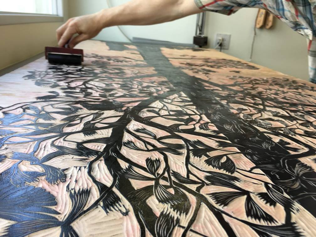 Rolling Ink Onto Carved Woodblock[1].jpg