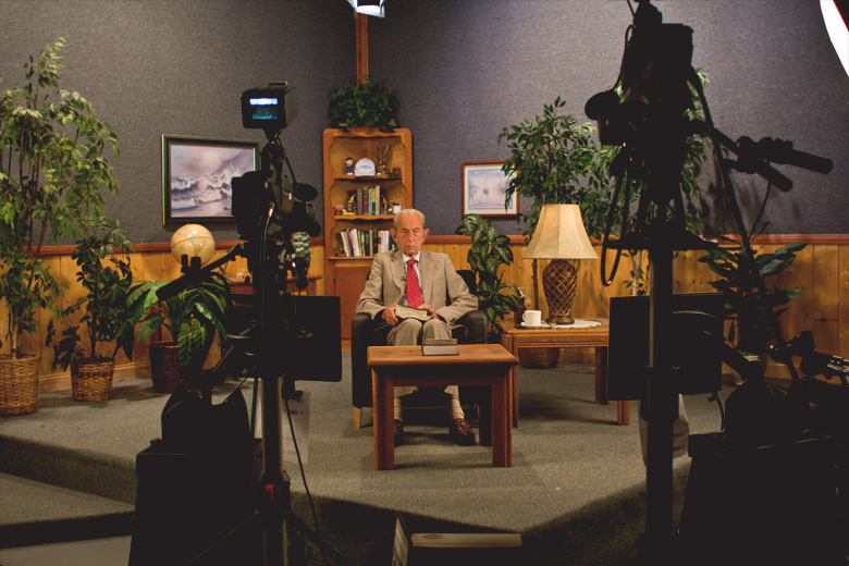 Camping prepares for Open Forum, a live talk-telephone program broadcast daily on radio and TV.