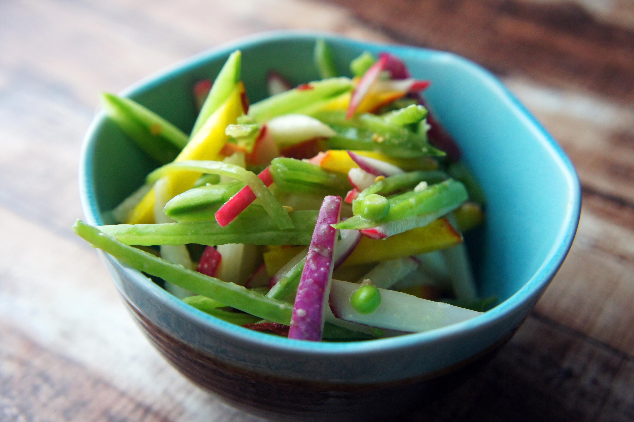 Snap pea, radish, and golden beet slaw with lemon-sesame vinaigrette. Vegan and Paleo