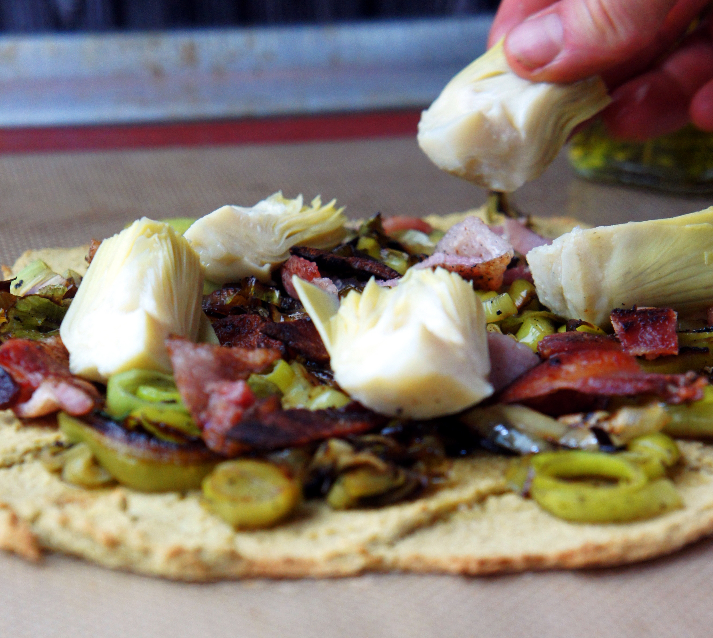 Nut-free paleo pizza crust! Caramelized Leek, Bacon, Artichoke Pizza