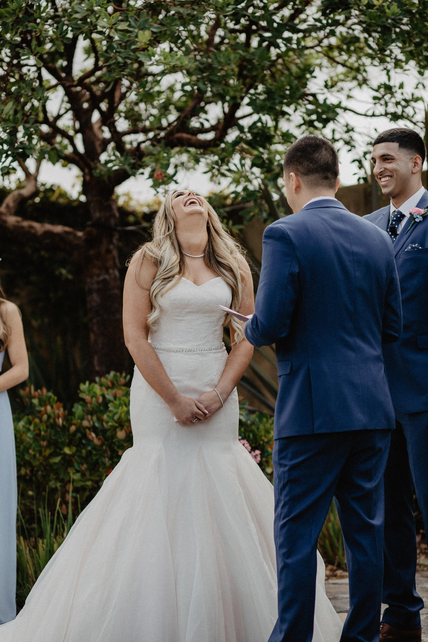 We were cracking up during our vows! I love that you can also see the pink in the layers of my dress, that was one of the main reasons I fell in love with this particular dress.