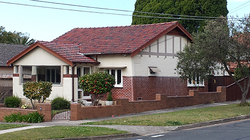 Sydney ~ $2 million USD will buy you an old, unrenovated 3 bedroom, 1 bathroom, 1,800 sq ft house in a nice suburban neighborhood 20 minutes outside central downtown Sydney.