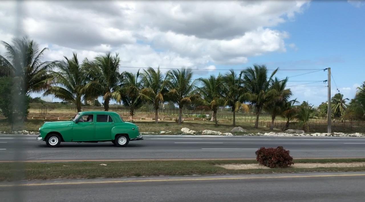 Green Car on Highway.jpg