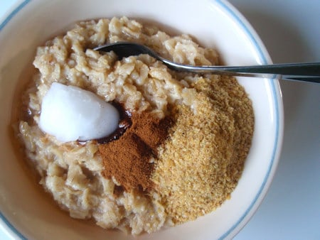 Oats is a carb and adding just sugar to that makes for a blood sugar spike and little hunger control later. You want to always add some fats with your meals to balance out the blood sugar level - nothing wrong w carbs not adding a dash of sugar, just make sure you are eating balanced and NOT lowfat. Lowfat spells disaster in recovery.