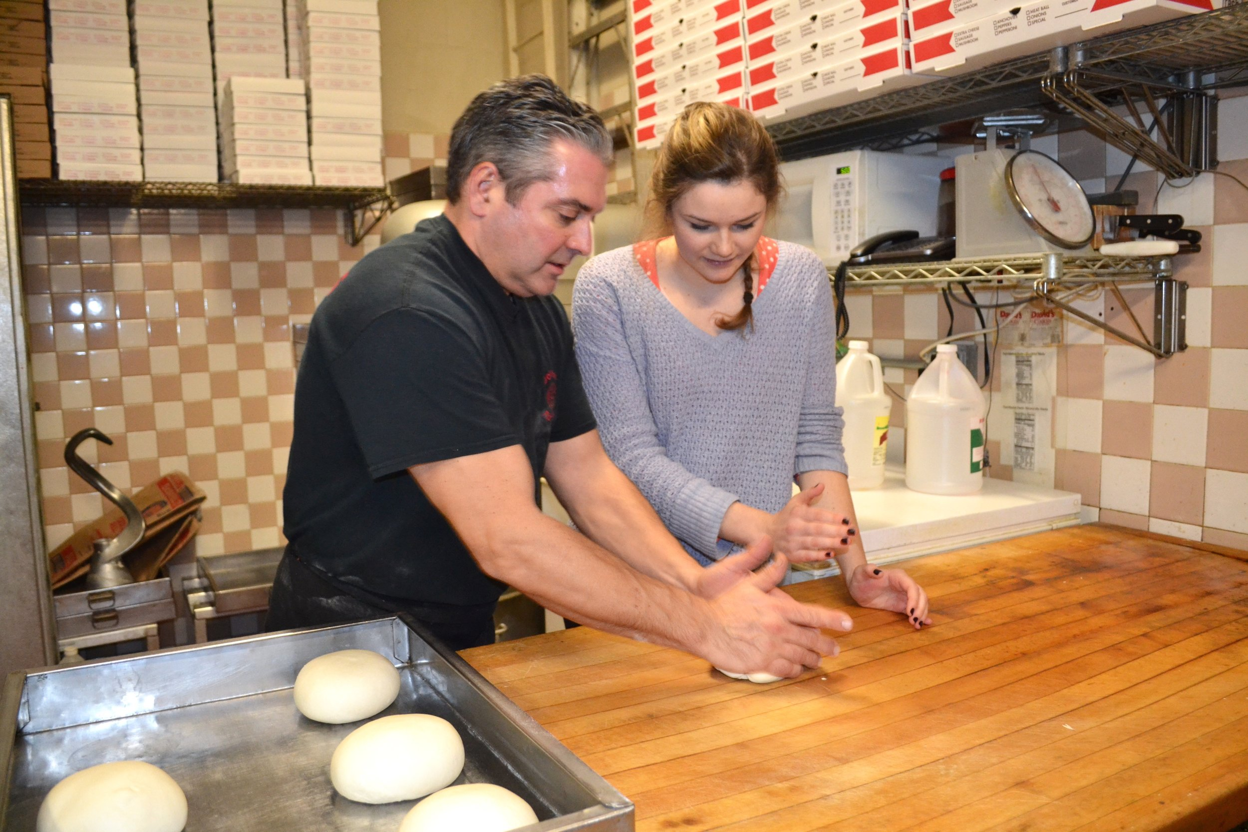 My friend, Lizzie, making pizza with Antonio in Brooklyn