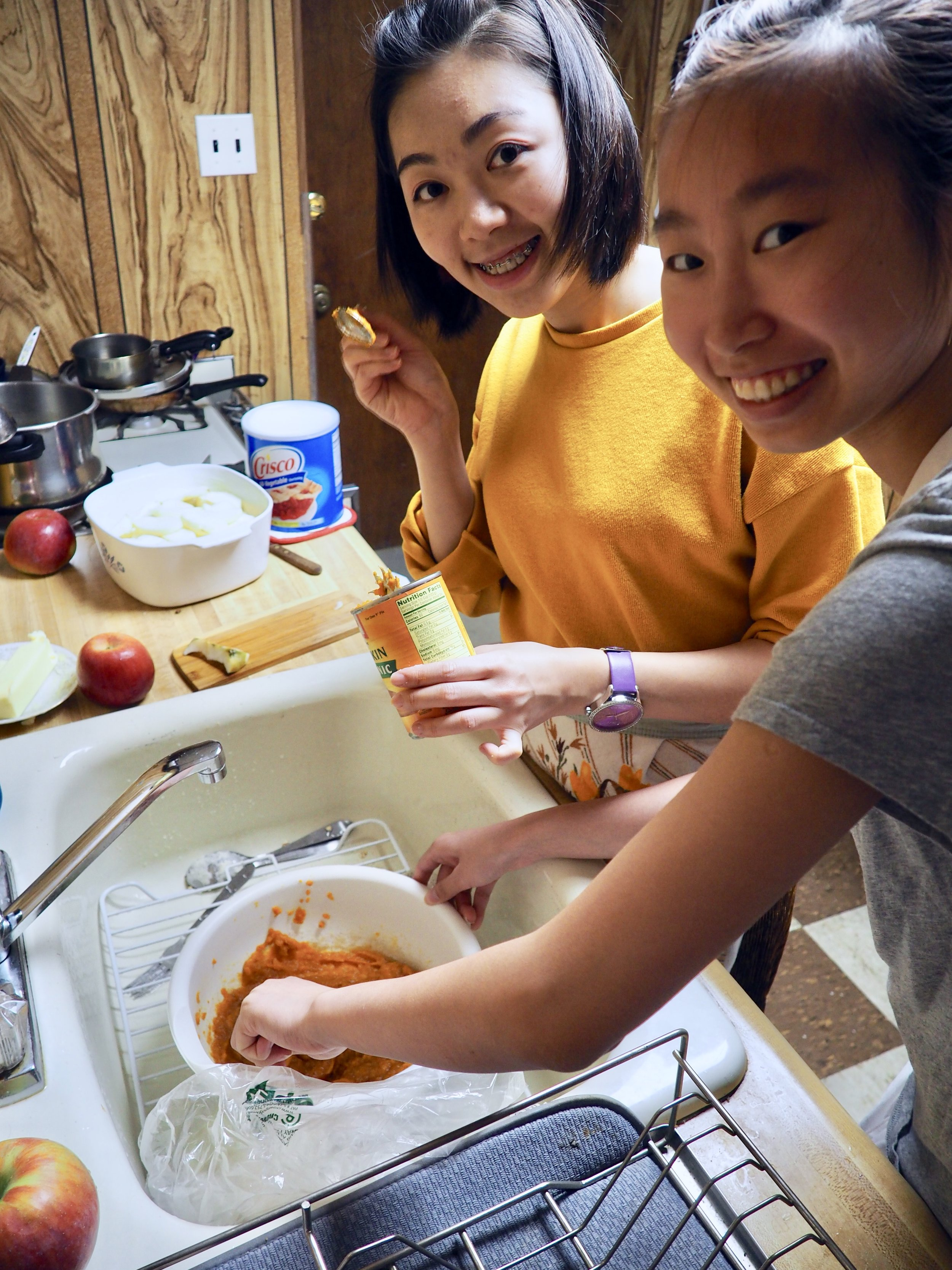 "Julia (left) and Tiffany (right) questioning the orange goo that is ""pumpkin puree"""