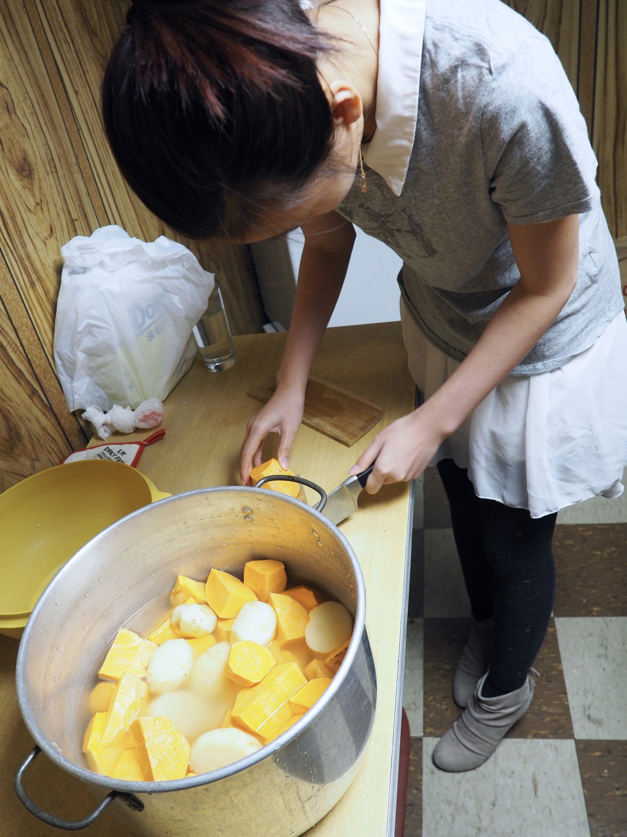 Tiffany at work on the potatoes