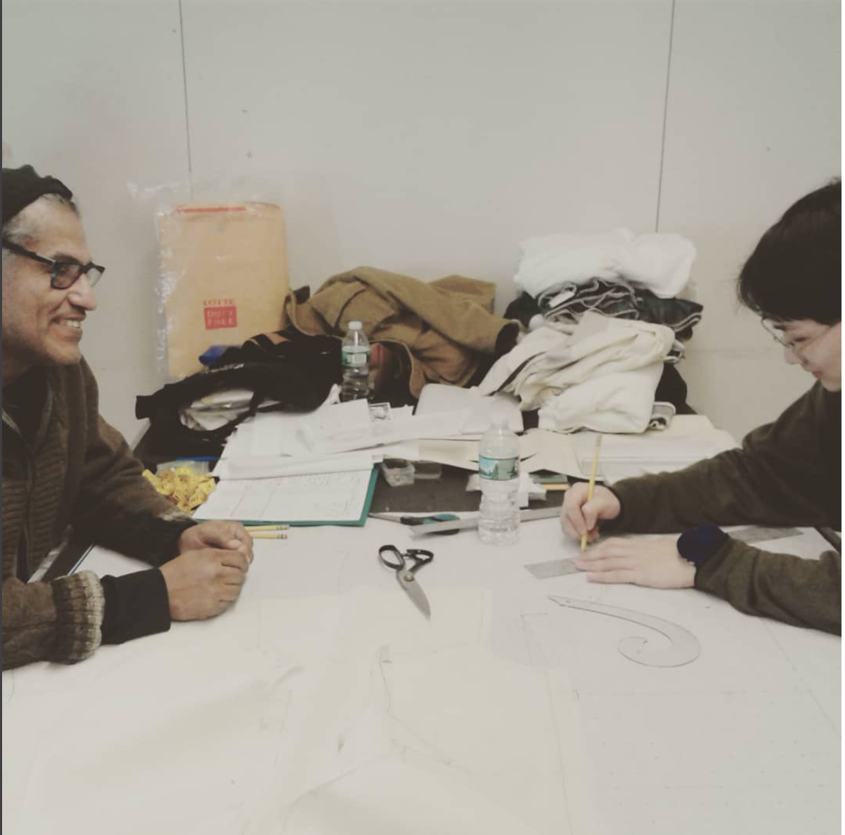 Mario and another FIT Student working on pattern drafting