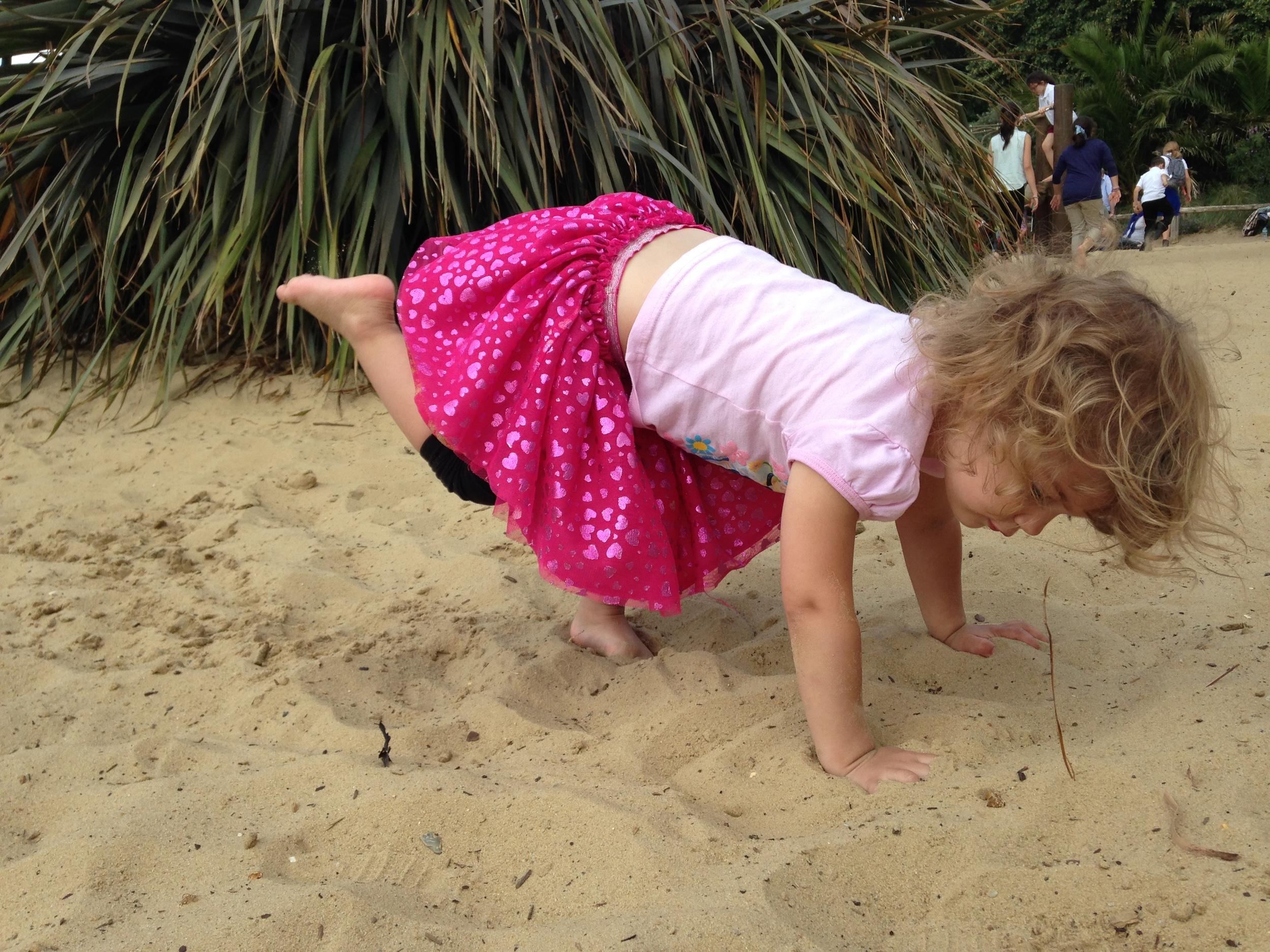 Baby Yogi - Downward Dog on the Sand