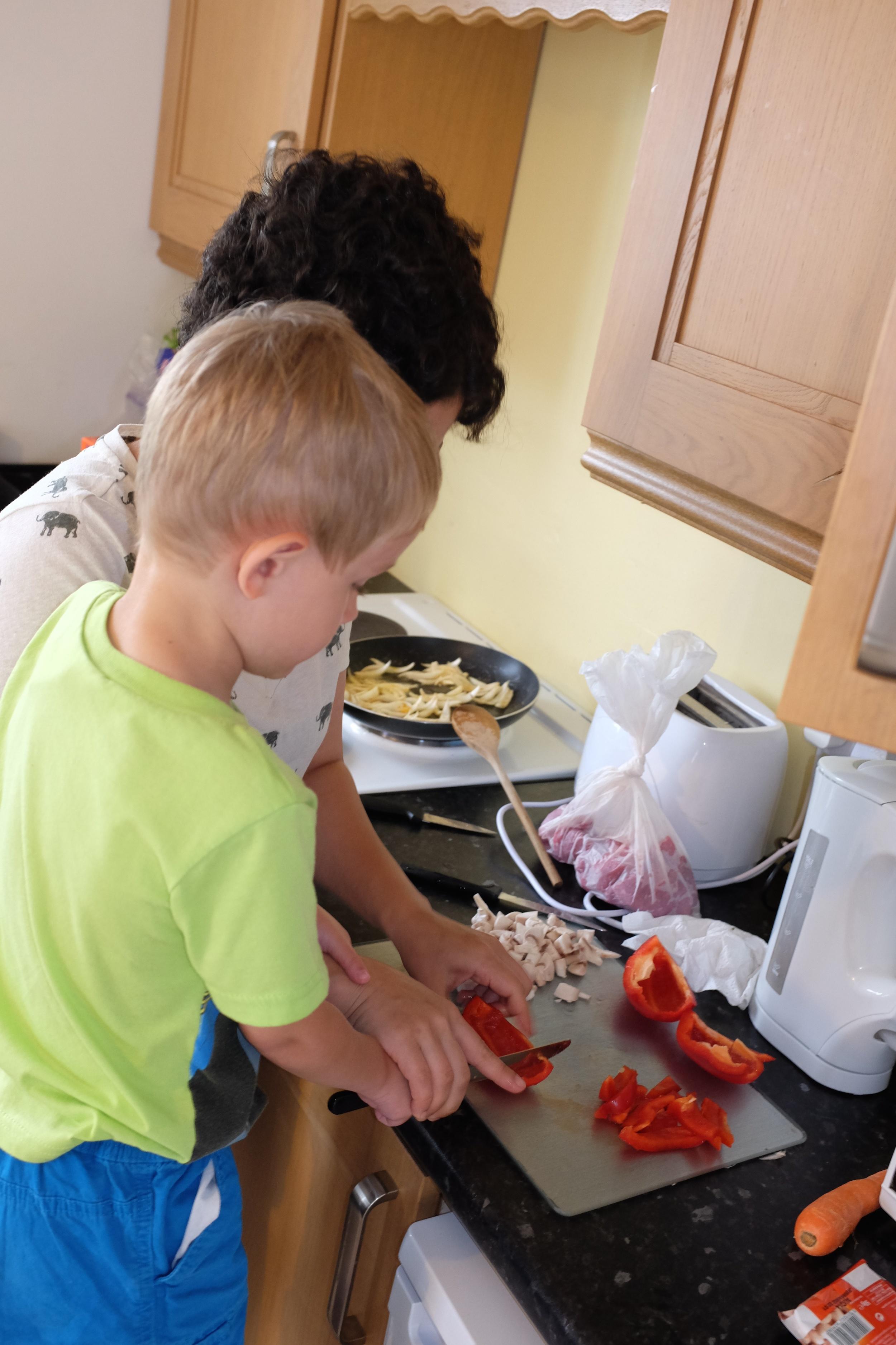 Teaching Kian how to cut peppers