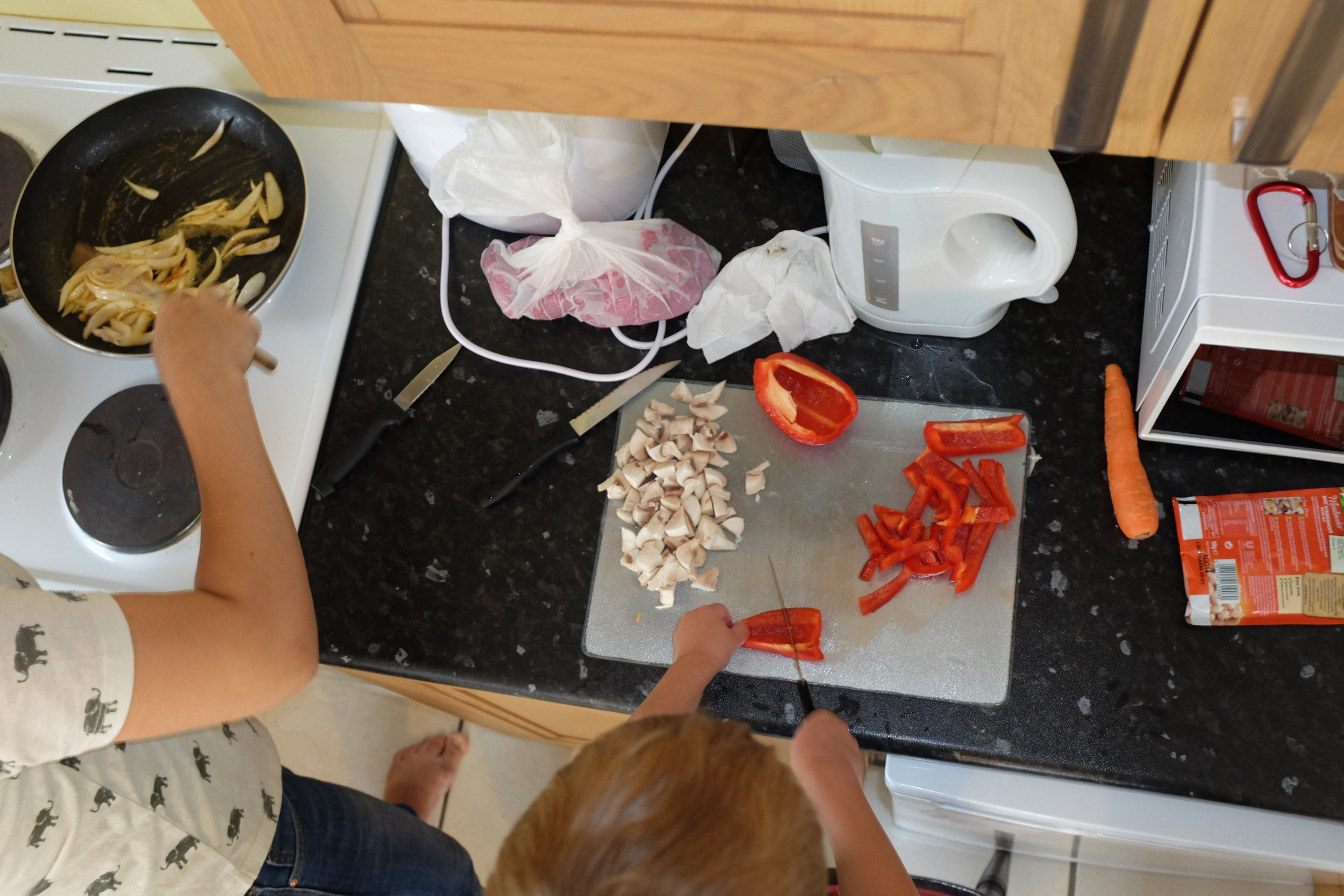 Kian mastering the art of cutting peppers :)