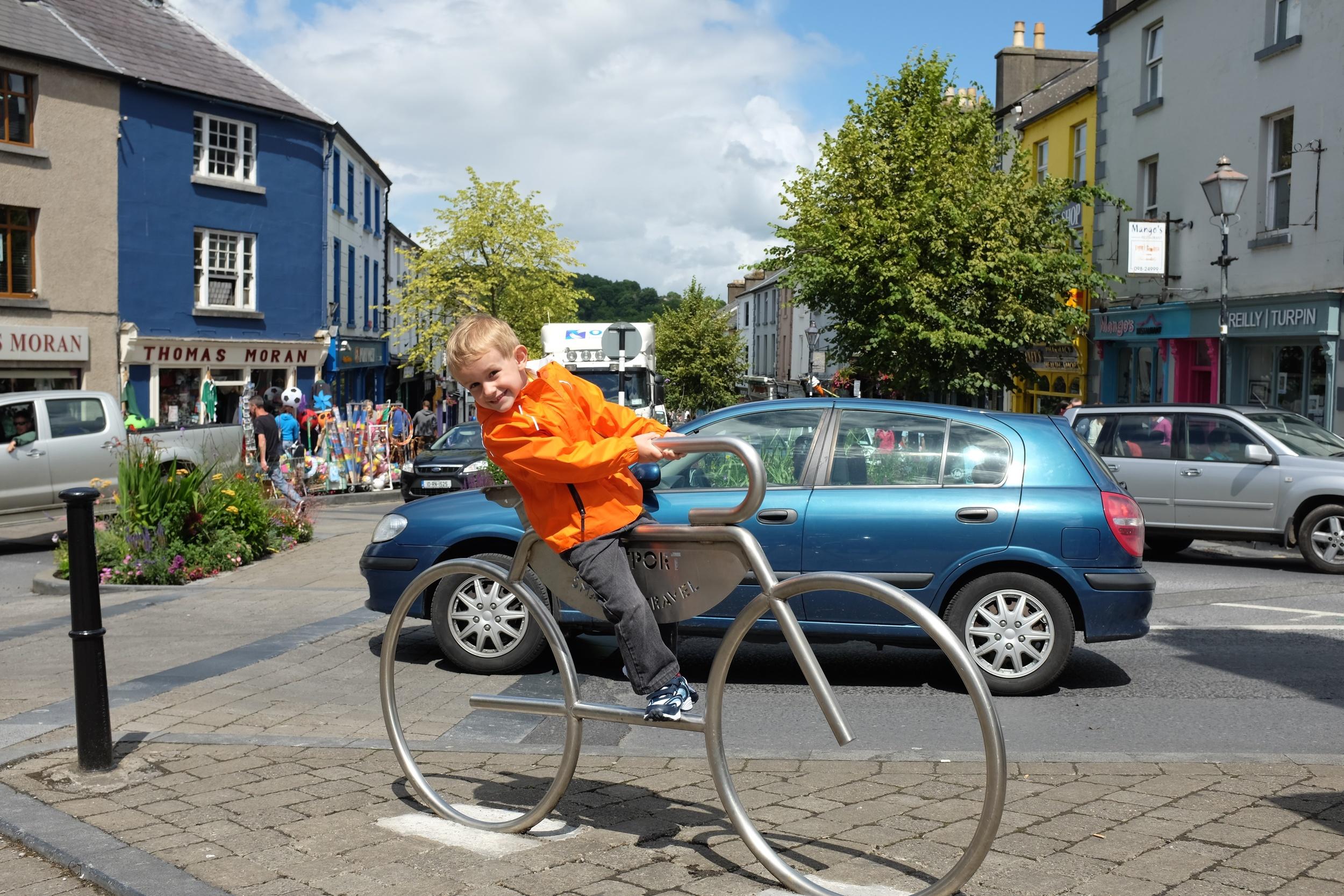 Kian on the metal bicycle