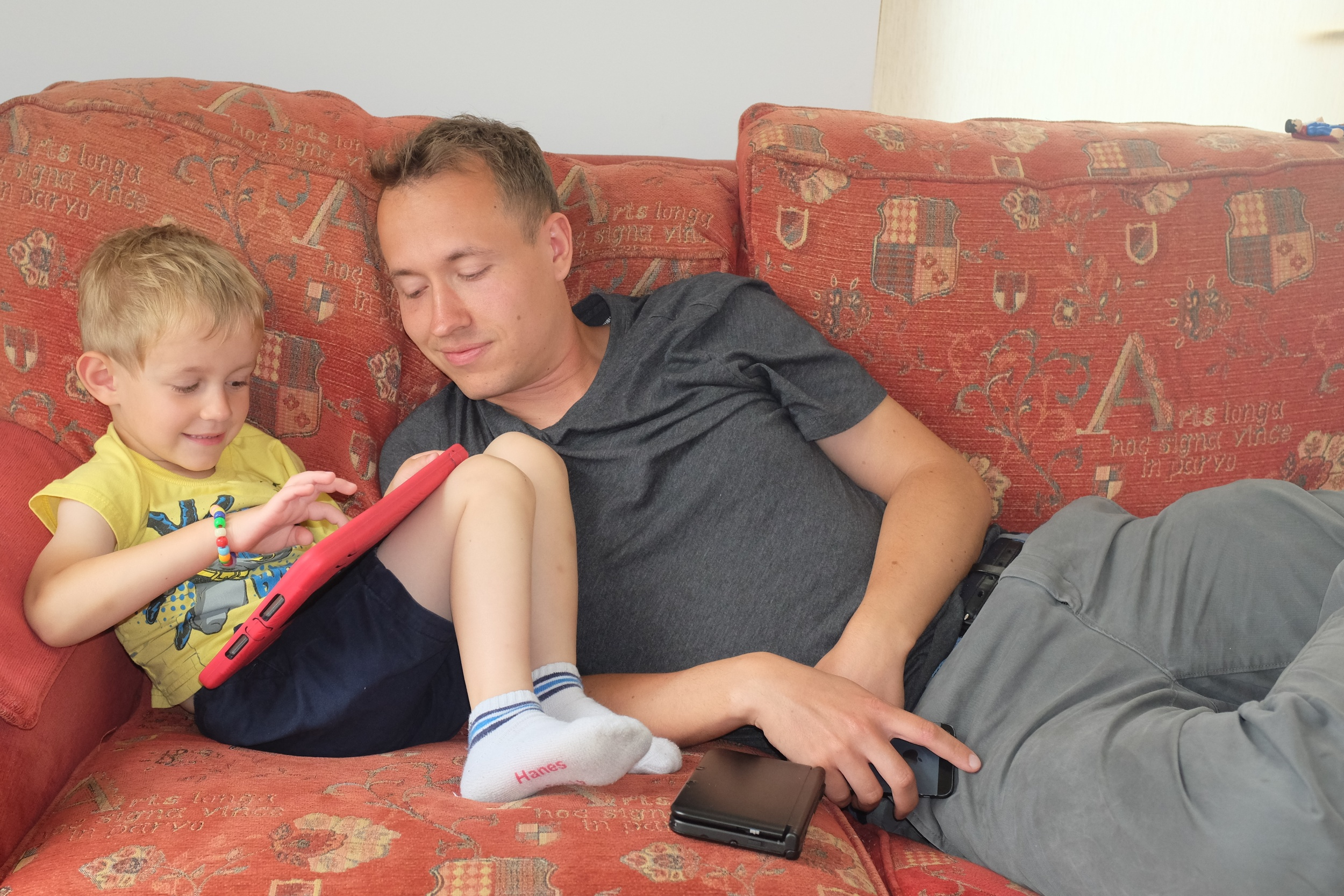 Kian playing Lego Star Wars on the iPad while daddy gives him helpful hints
