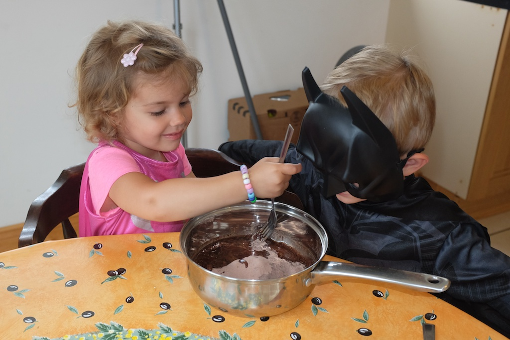 Batgirl working on the brownie mix