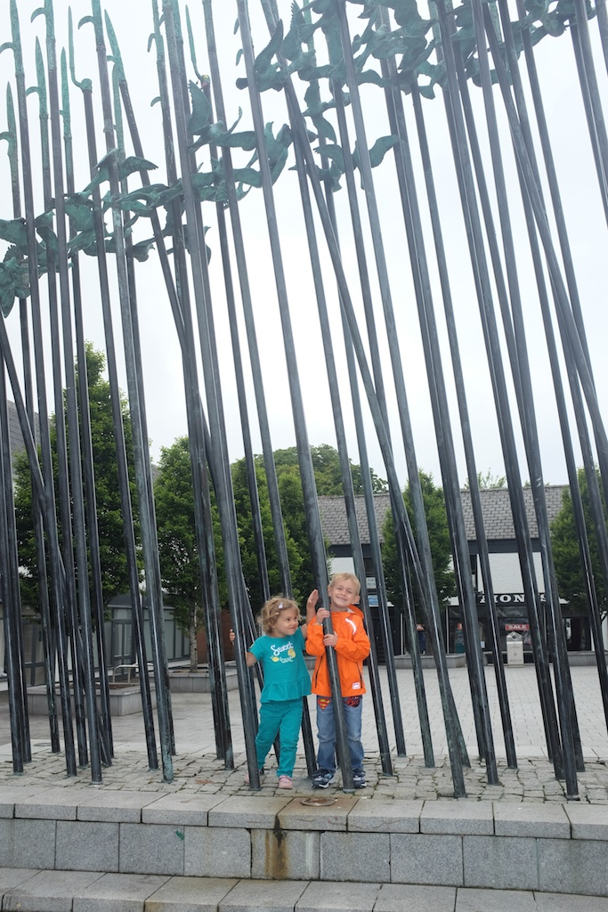 """Kian and Hannah posed with the """"Bronze and Stainless Steel artwork, evoking the 1798 rebellion and in particular the episode known as the """"The Races of Castlebar"""". The cloud of doves signifies the reconciliation after conflict."""""""