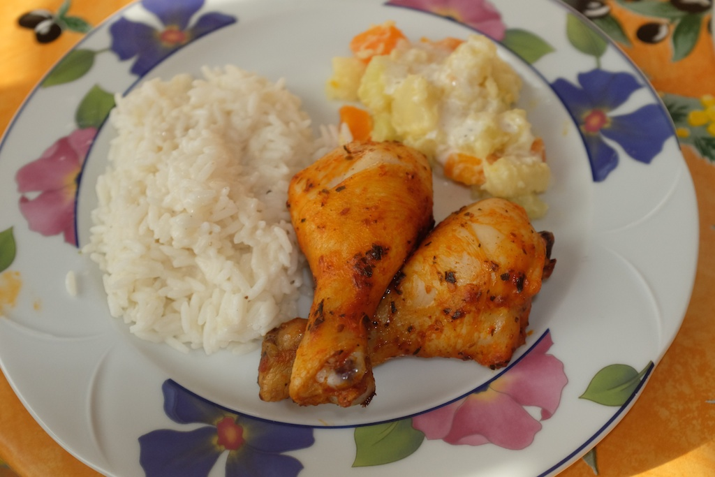 Marinated chicken legs baked in the oven with rice and veggies made in coconut milk