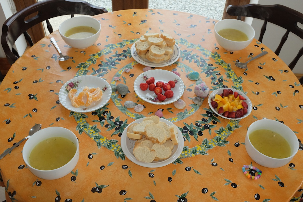Chicken noodle soup with bread and fruit