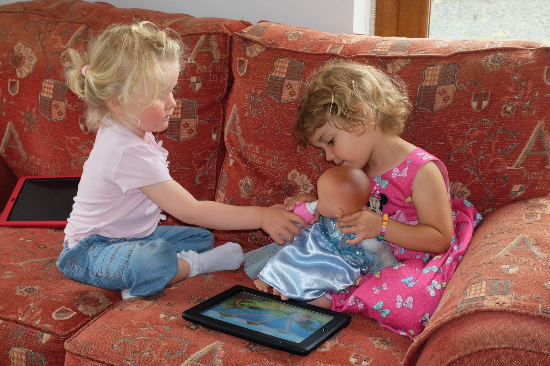 Ciara and Hannah feeding baby Ginger