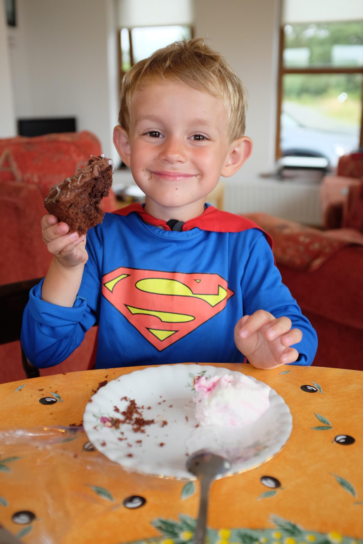 Kian loving his slice of chocolate cake