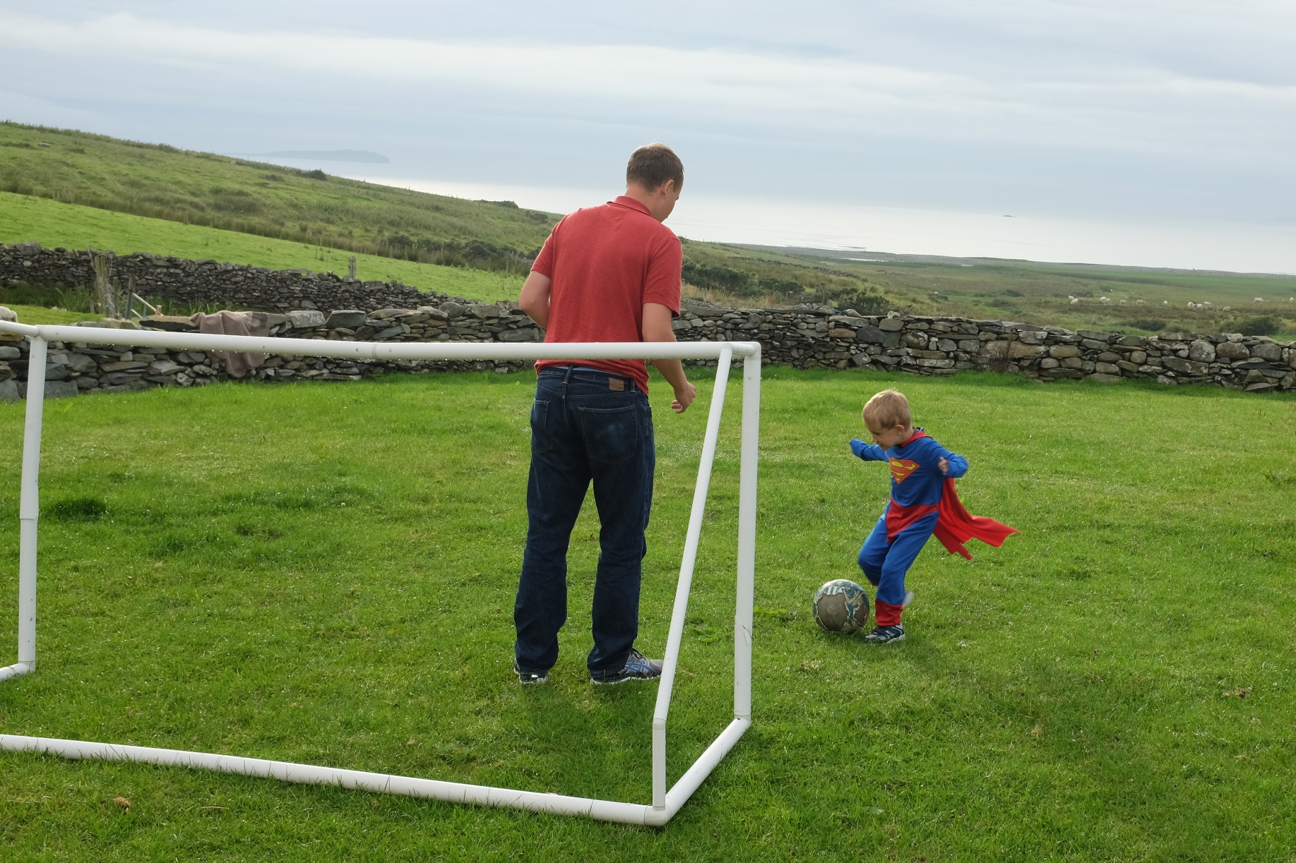 Superman getting ready to kick the ball.. it's never a fair match when you're up against Superman!