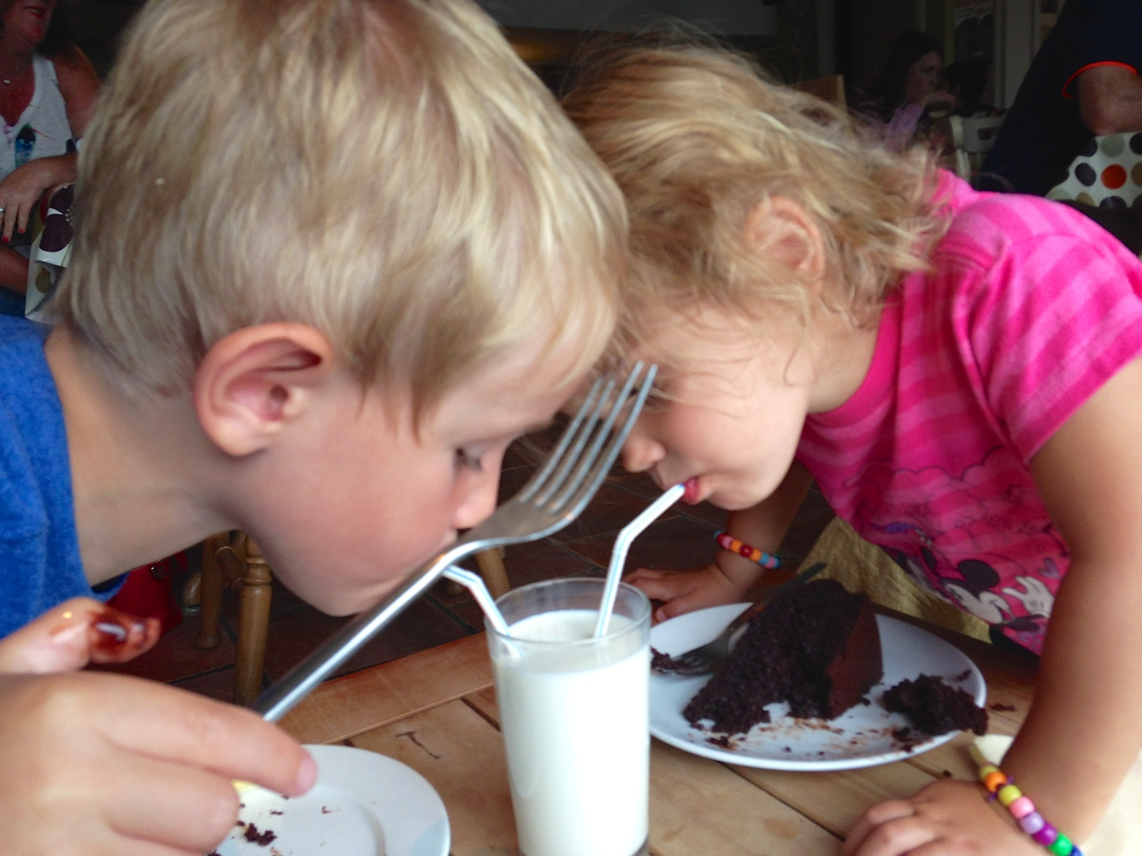 Little swimmers loving their delicious chocolate cake and milk