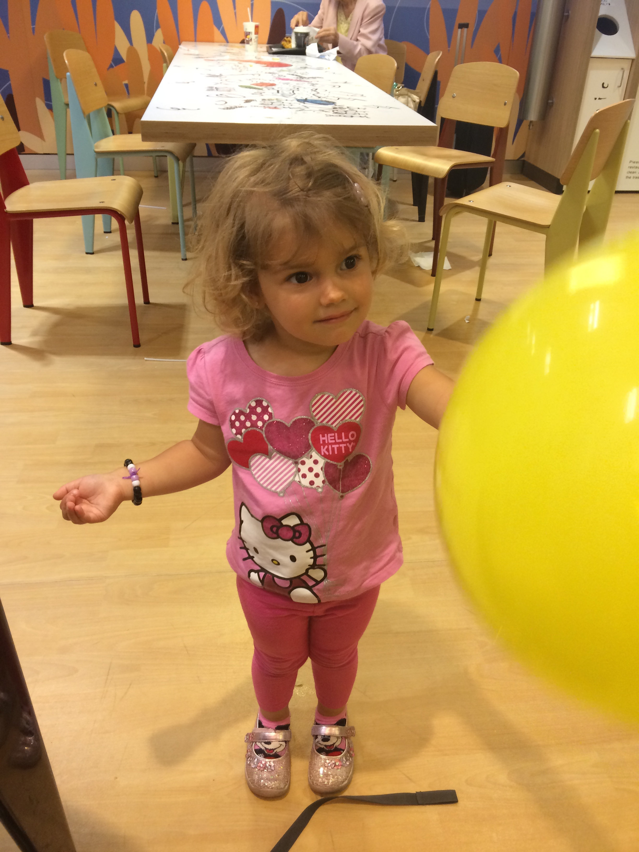 "Hannah and her yellow balloon that she left for ""other kids"" after we left the play area"