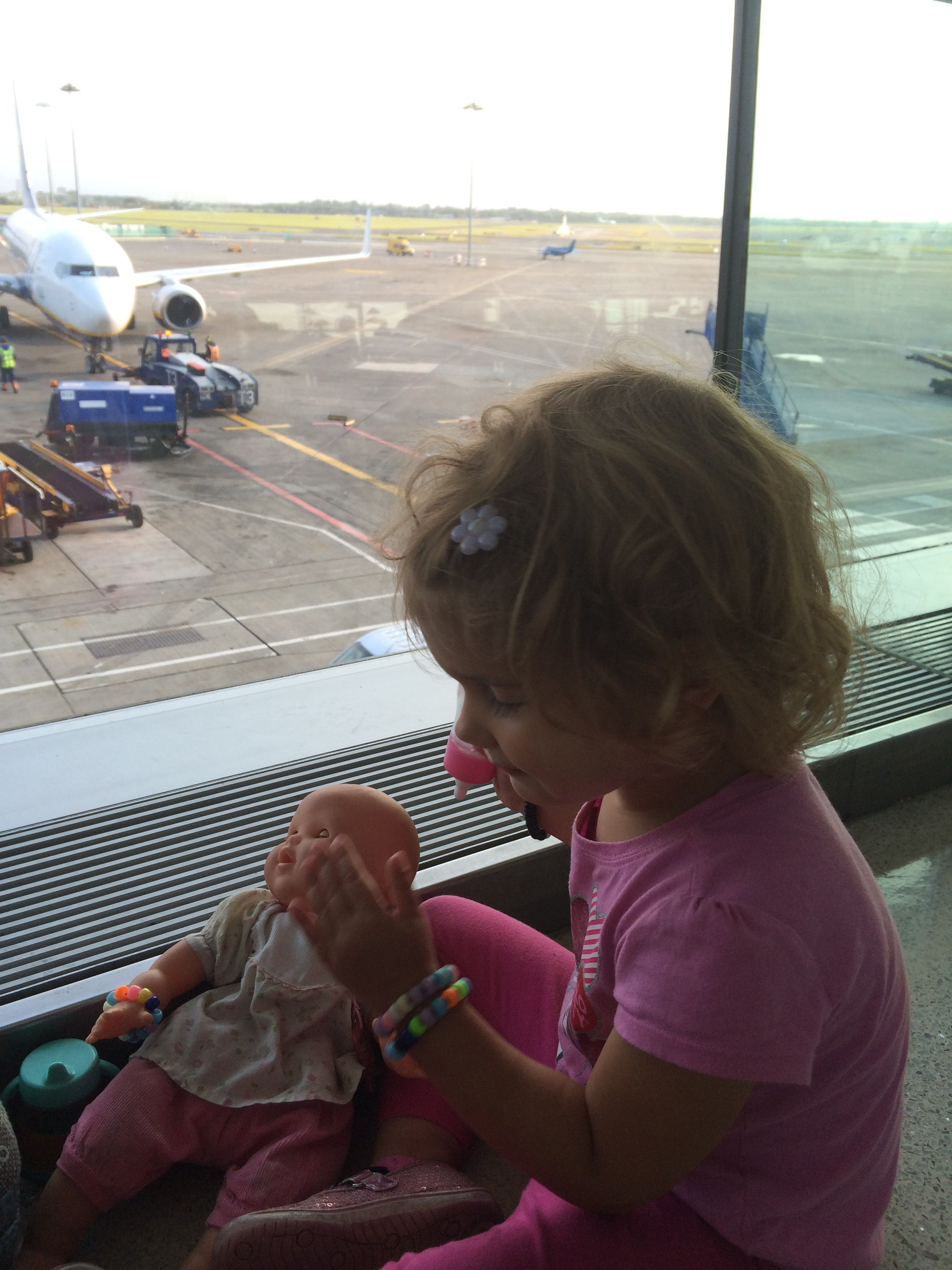 Hannah feeding baby ginger while we waited to board