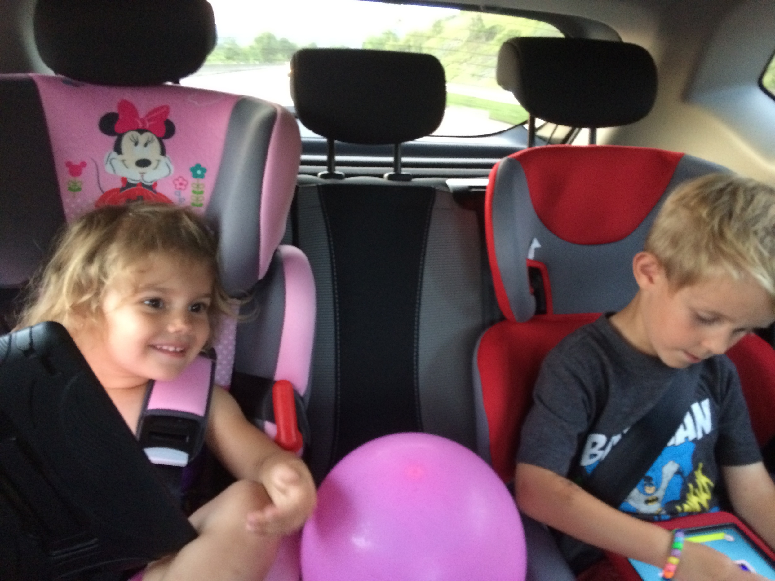 Kids strapped into their new car seats