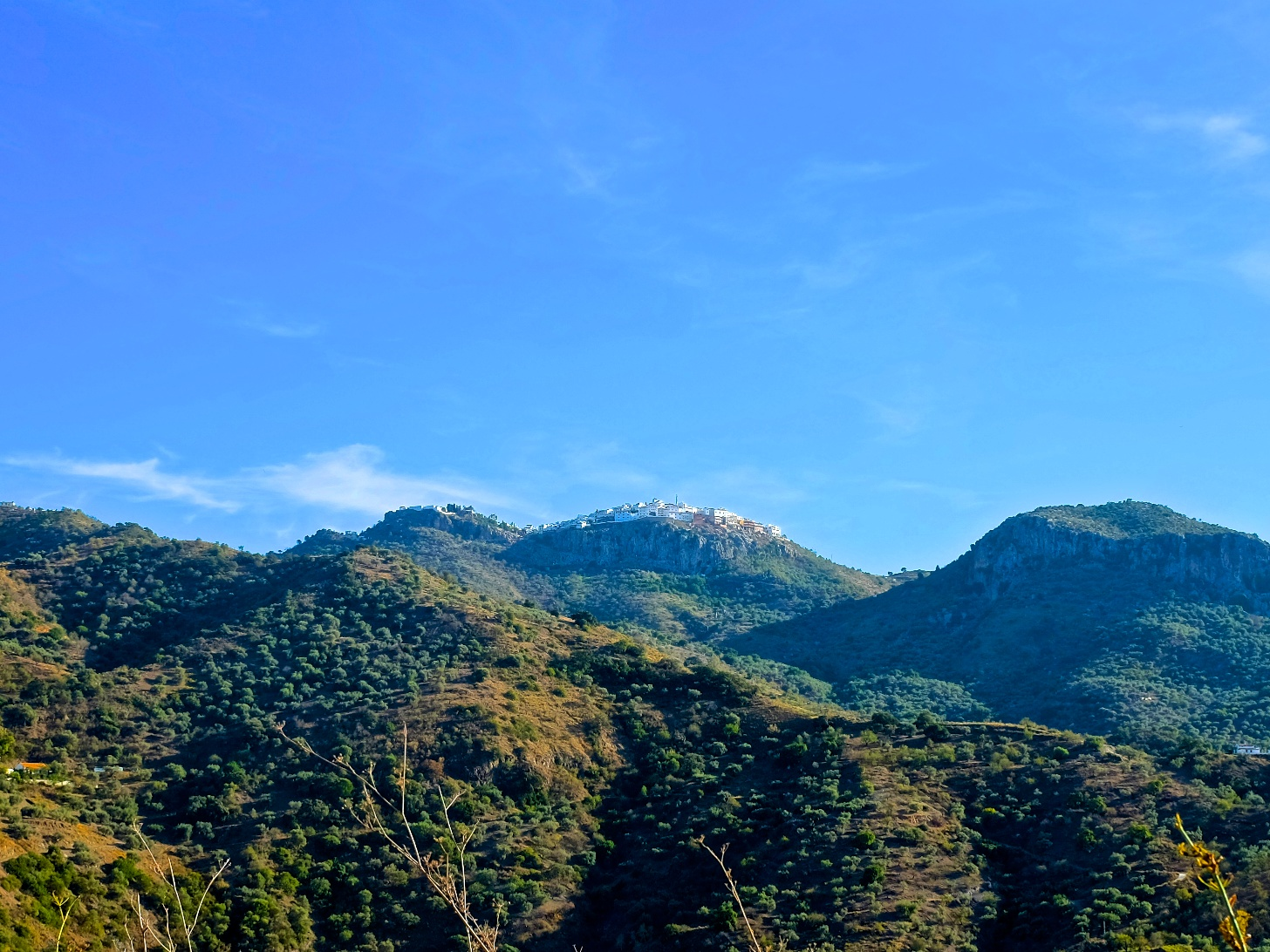 If you look closely at the top of that middle mountain, you can see the village of Comares