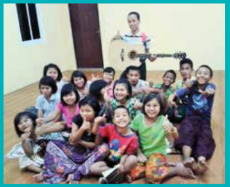 The Damadi kids with their new guitar