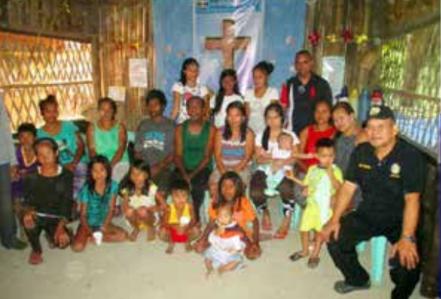 Pastor Primo Bodena (in black), LAMP treasurer, with the Dumagat people
