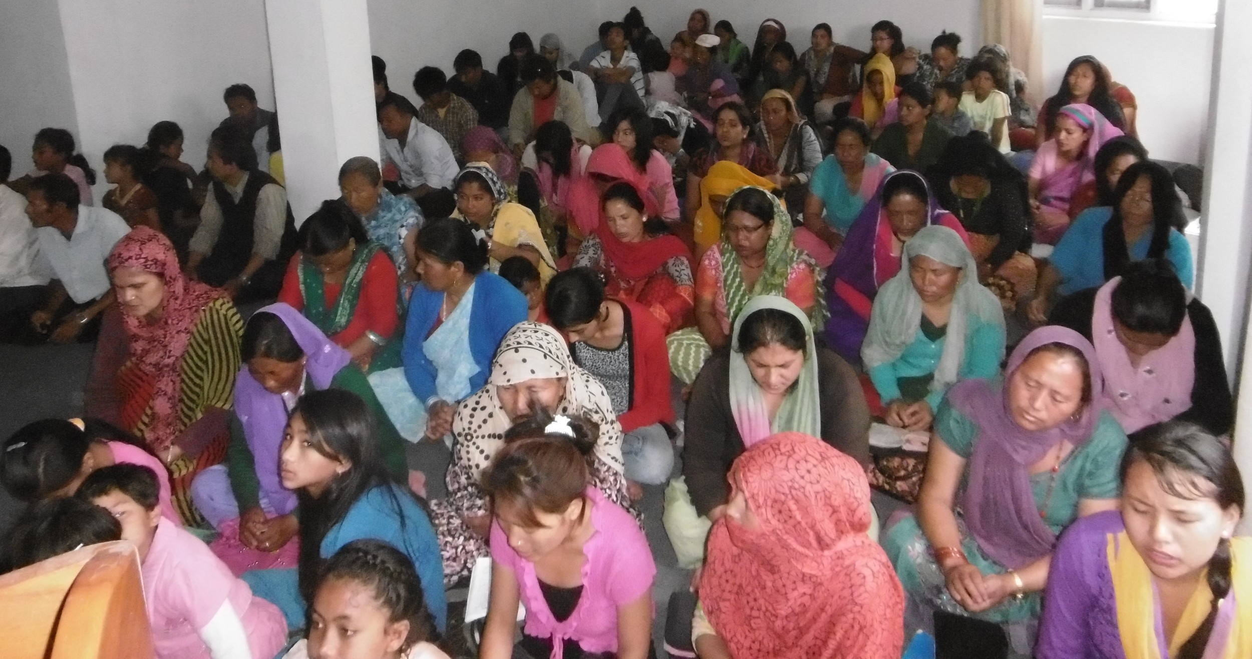 Part of Mukunda's congregation at worship. He started with nothing but has 200 worshippers now.