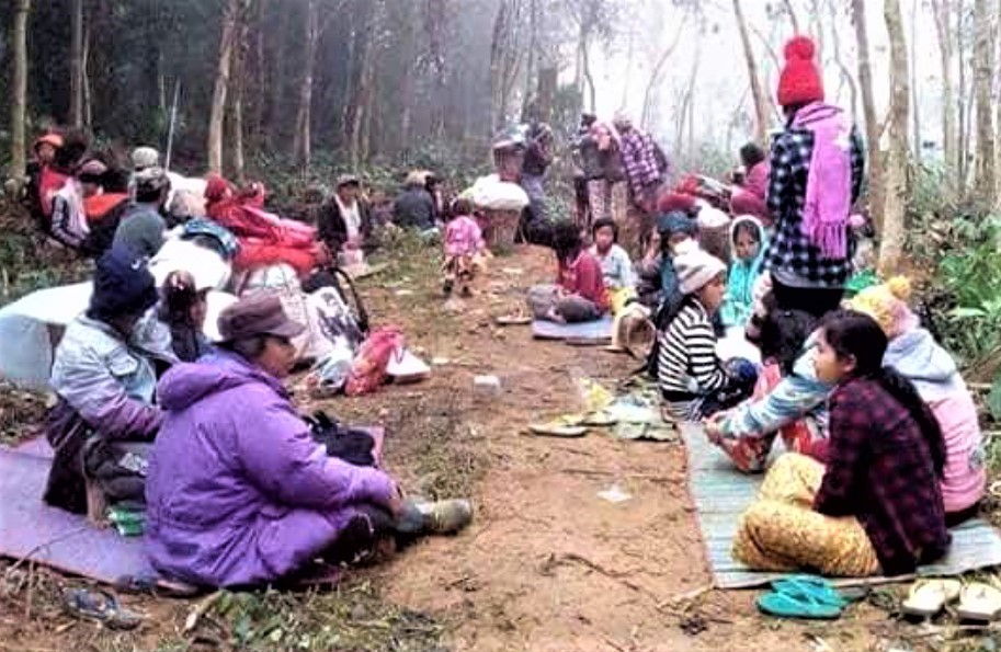 REFUGEES FLEEING FOR THEIR LIVES - resting in the jungle. Where will they go? Are they still alive?